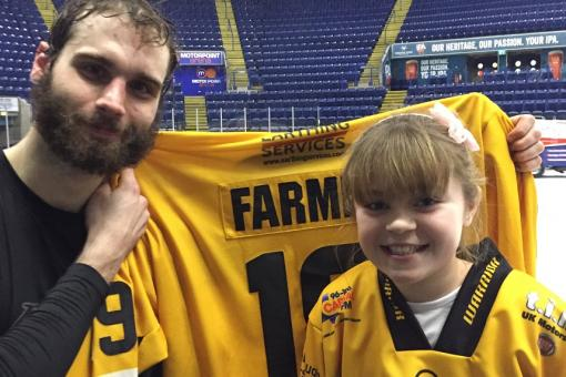 Twelve year old Mia wins Farms' shirt in Wednesday night's raffle