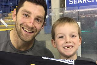 Young Panthers fan wins Mosey's jersey
