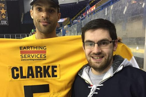 Shirt raffle winner Alex snags Clarkey's shirt