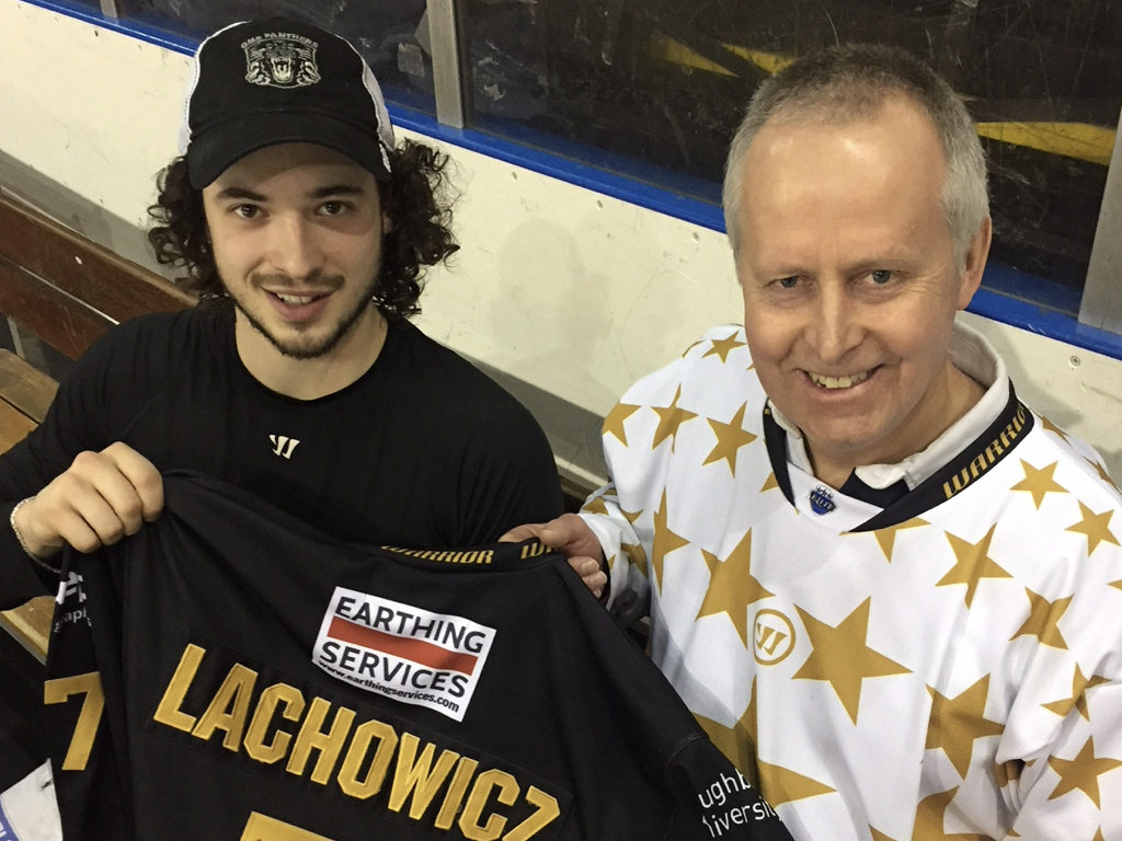 Fan Philip came in a Festive replica shirt and left in Lacho's game worn Number Seven jersey Top Image